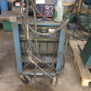 miller deltaweld 452 with 4 roll feeder works great