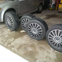 215 60 17 Arctic Claw Winter Tires on 5x114.3 Rims with Covers