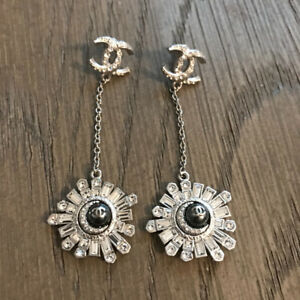 Authentic 2017 Chanel Star and Moon Earrings