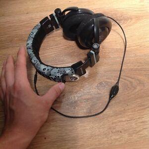 Skull candy headphones with custom bottle opener inside