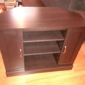 Corner TV stand for sale - dark wood colour- excellent condition