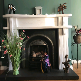 Iron cast fireplace, with surround