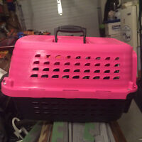 Petmate Kennel...... (pink) size is 19 inches long by 13 inches