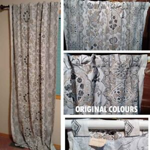 Two Curtain sets. Flower-like print.