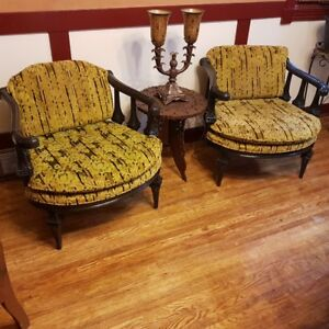A pair of unique vintage round seated chairs