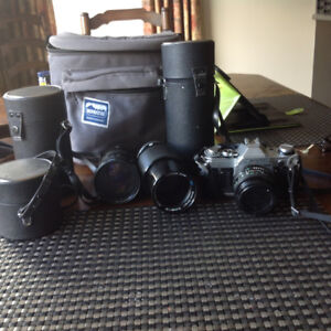 Vintage Canon AE-1 camera and three lens