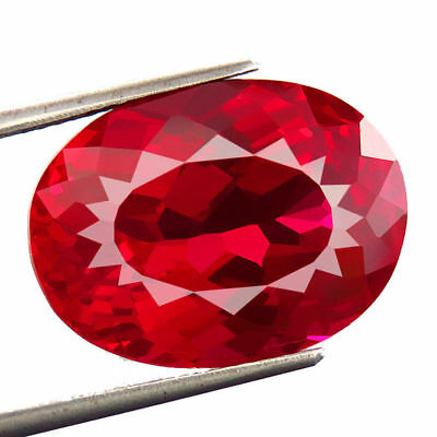 A PAIR OF 6x4mm OVAL-FACET TOP-RED LAB RUBY GEMSTONES