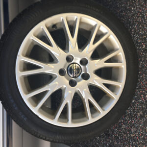 Set of four Volvo factory OEM Mags With New All Season Tires