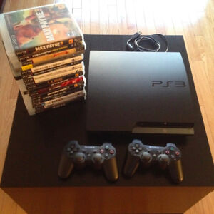 Play station 3 with two controllers and 17 original games