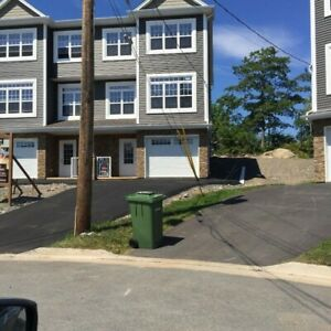 Executive three storey townhome in sought after Fleming Heights