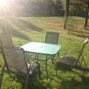 Patio glass table with 4 sling chairs