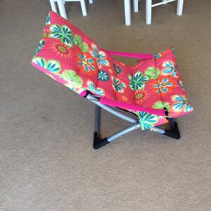 Chairs, floor lamp, chart