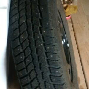 4 tires 215/70R15 studded winter tires WeatherMaxx mounted