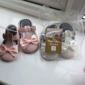 Two brand new baby girls shoes