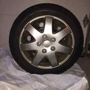 """4 Toyo 16"""" Winter Tires on rims with wheel covers"""