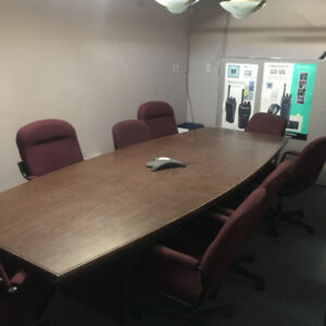 Conference room table with 8 chairs