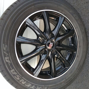 Black sport mags like new with used toyo tires.