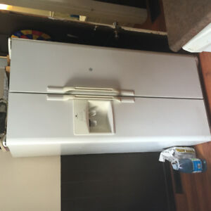 8 year old side by side refrigerator/freezer. Good condition!