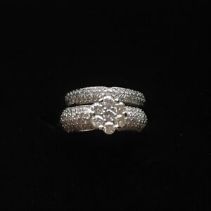 White gold engagement ring and matching wedding band