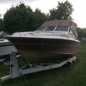 NEW PRICE: Priced to sell ! Complete with Boat and 2 Axle Traile