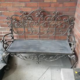 Ornate wrought iron bench