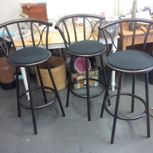 Three metal bar stools