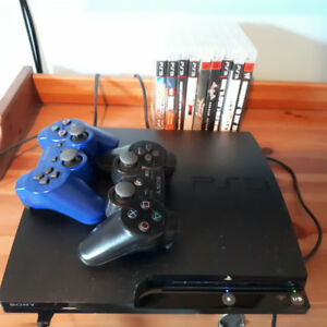 Sony PS 3 with 2 controllers/  9 games!