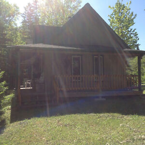 Camp/cottage with 3.3 acres on the Elm Tree river