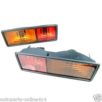 Land Rover Discovery 300tdi Rear Bumper Clear Lamps /& Orange Bulbs x2 Bearmach