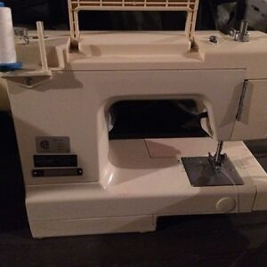 Sewing machine with matching case & accessories