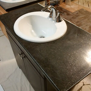 Vanity with Moen faucet, sink and counter