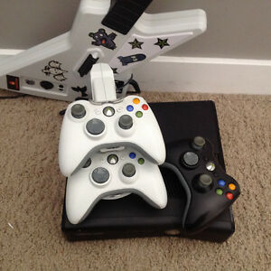 Xbox 360 with 3 controllers, guitar and 38 games Edmonton Edmonton Area image 1