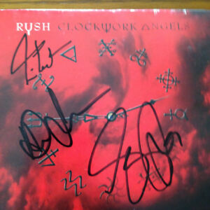 RUSH Autographed CD cover all 3 sigs