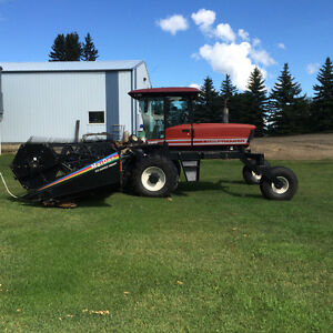 2003 2952 premier swather 1044 cutting hrs. Excellent condition