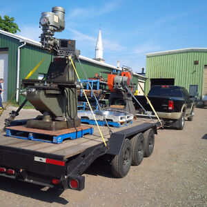 18-1/2 FOOT LONG TRI-AXLE FLAT BED TRAILER FOR SALE