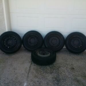 4 used winter tires with spairtire 420$ obo