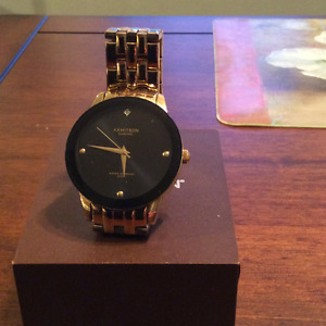 Gold Armitron watch