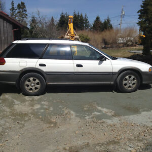 1999 Subaru Outback for fix up or parts.