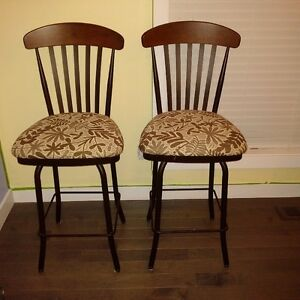 Two Swivel bar chairs classy look to them