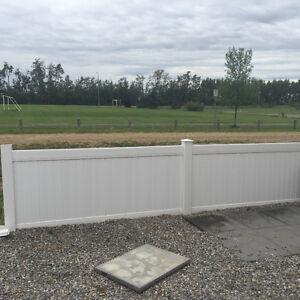 White Vinyl Fencing with Gate.