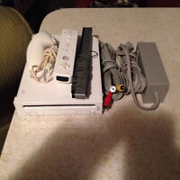 "Console Nintendo Wii + 4 Jeux + 1 Manette +1 ""Nunchuk + filages"