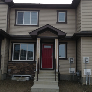 Brand NEW Townhome with Double Car Garage in the Meadows