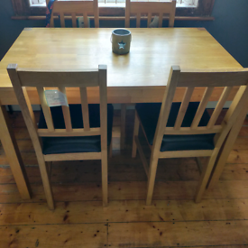 Solid wood Table & 4 Black leather chairs
