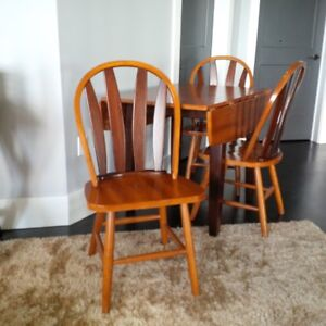 Maple drop-leaf table and four chairs.