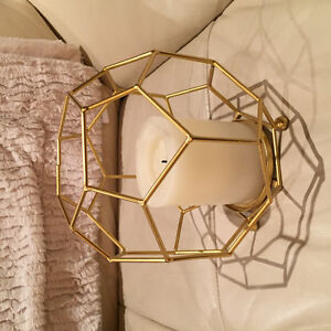 Gold accent piece with candle