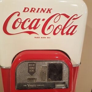 VINTAGE COKE MACHINE IN WORKING CONDITION!