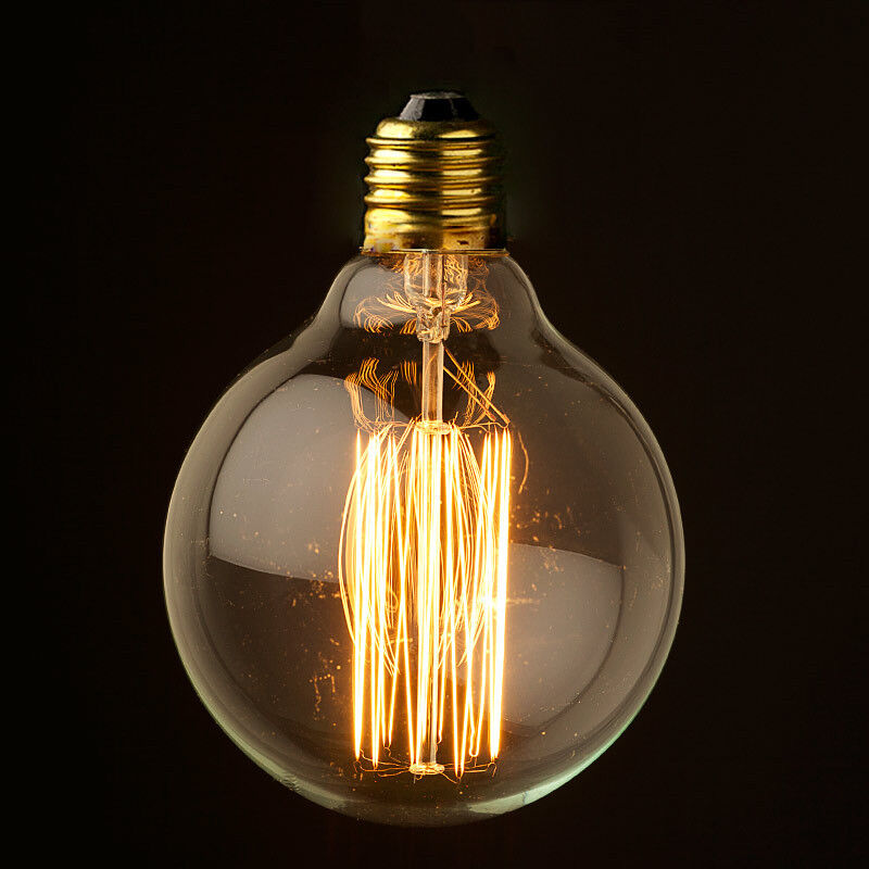 This is a squirrel cage filament globe shaped vintage bulb