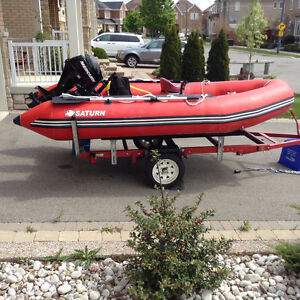 Inflatable Saturn 12Ft. 3 yrs. old w/9.9 HP Mercury