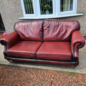 Thomas Lloyd red leather settee