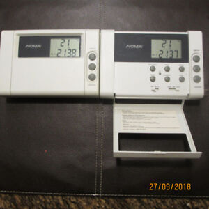 Two (2) Noma Programmable Thermostats